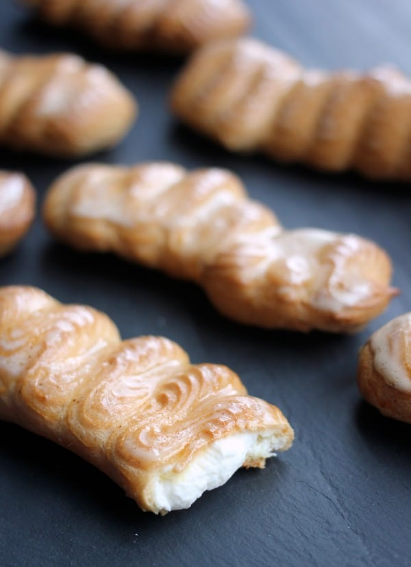 Eclairs with Espresso Glaze and Cinnamon Whipped Cream- Baker Bettie
