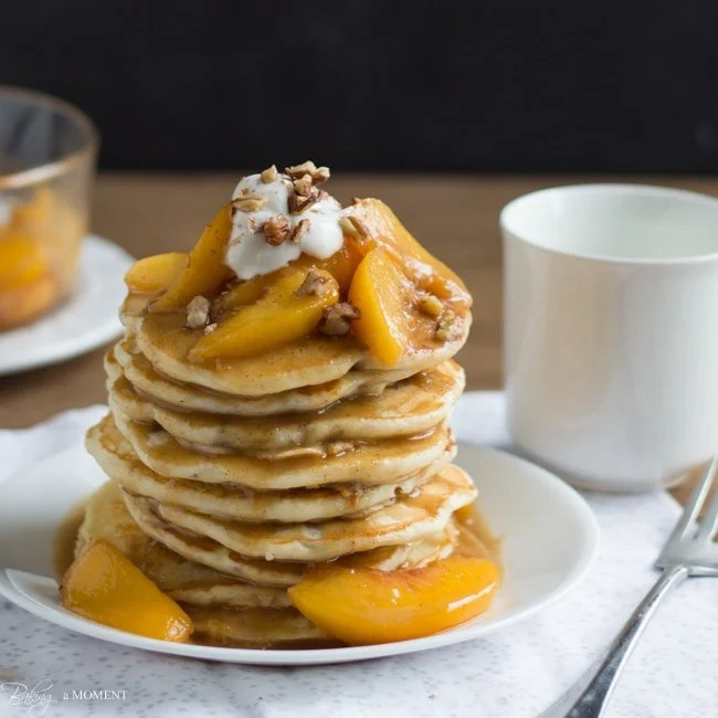 Toasted Pecan Pancakes with Brown Butter Bourbon Peach Syrup | Baking a Moment