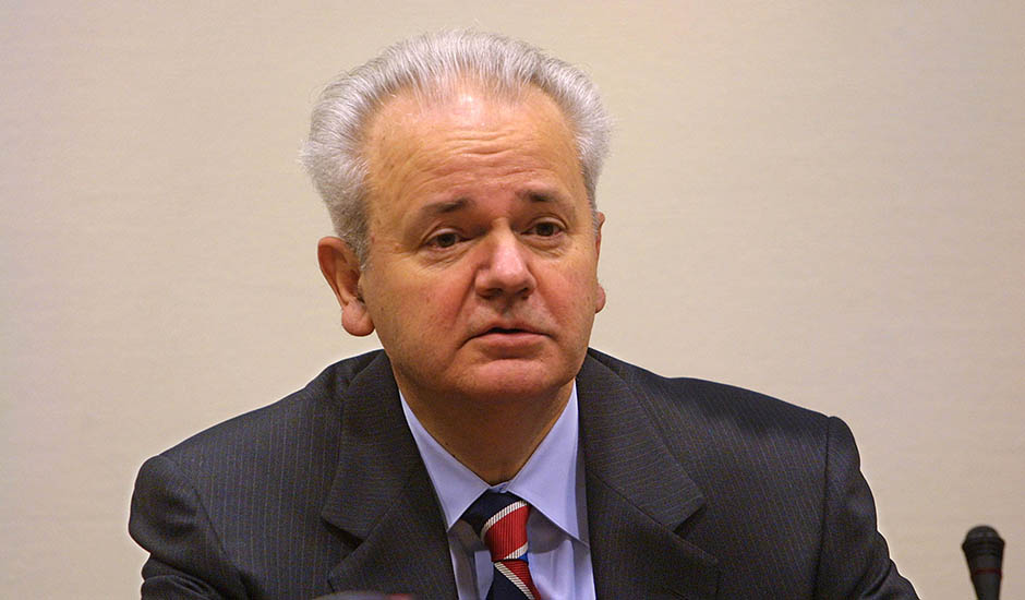 401052 01: Former Yugoslav President Slobodan Milosevic appears for his third trial day at the War Crimes Tribunal February 14, 2002 in The Hague, Netherlands. Milosevic began the trial defense by showing a documentary which claimed that NATO had violated international law by bombing Yugoslavia in 1999. (Photo by Michel Porro/Getty Images)