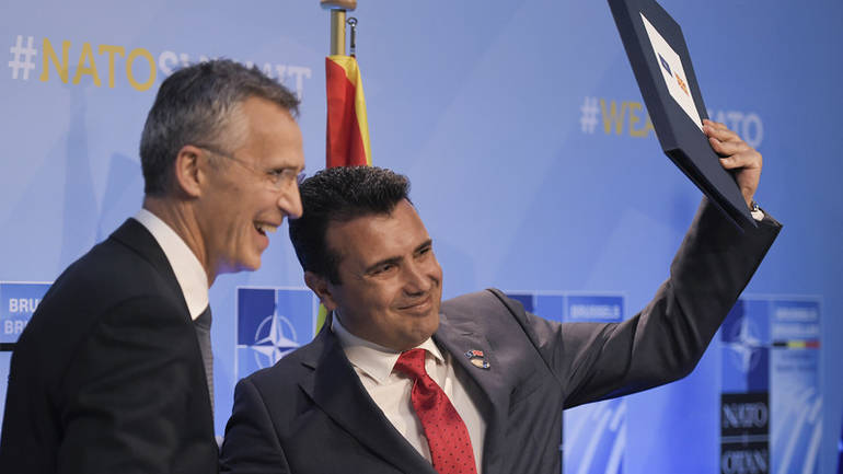epa06883604 NATO Secretary General Jens Stoltenberg and Prime Minister of the Former Yugoslav Republic Of Macedonia (FYROM), Zoran Zaev (R) during signature of an agreement on the sidelines of the NATO Summit in Brussels, Belgium, 12 July 2018. NATO member countries' heads of states and governments gather in Brussels on 11 and 12 July 2018 for a two days meeting.  EPA-EFE/CHRISTIAN BRUNA