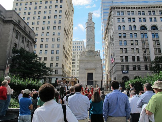 A crowd gathers at the Battle Monument as part of the Star-Spangled Spectacular, the bicentennial commemoration of the defense of Baltimore, in 2014.