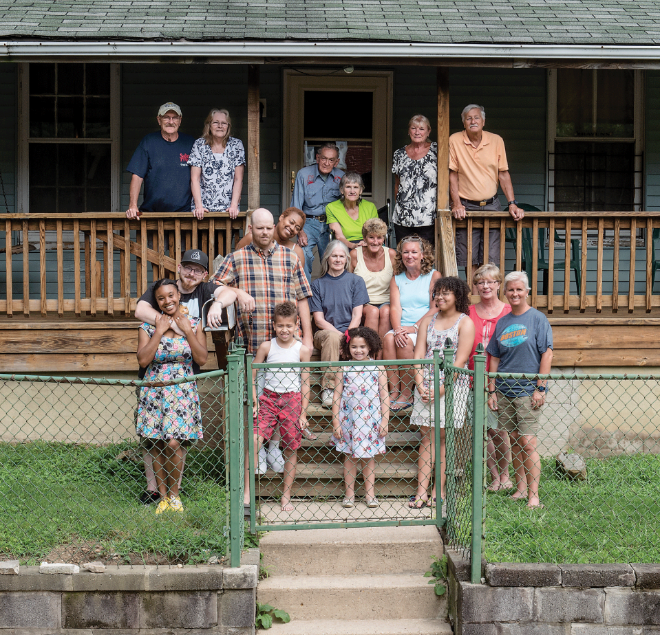 Four generations of the Smith family pose on their porch in Waverly. Photograph by David Colwell/Baltimore Magazine, 2015.