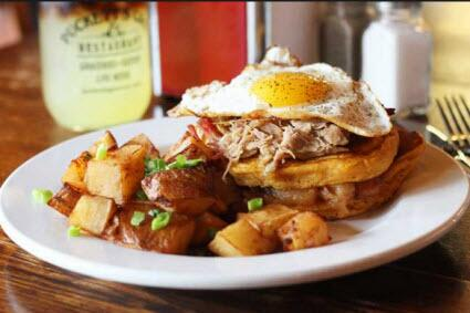 Southern Stack Pancakes at Puckett's, with Sweet Potato Pancakes, Smoked Pulled Pork, Egg, Fried Apples!