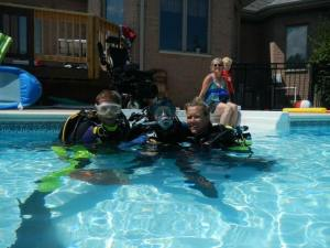 Adaptive diver Amber Rangel giving SCUBA a try. Photo courtesy of Amber Rangel.