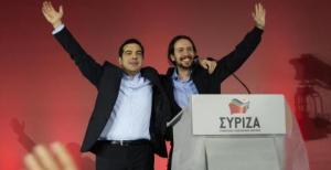 Greece's Syriza leader (L) Alexis Tspiras and Spain's Podemos leader Pablo Iglesias smile and wave to the cameras