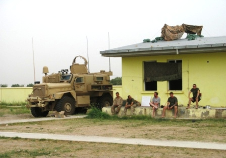 Marines and other deployed personnel relax during a quiet minute at the Yellow Schoolhouse in Marjah, Afghanistan.  Dan Lamothe//Staff
