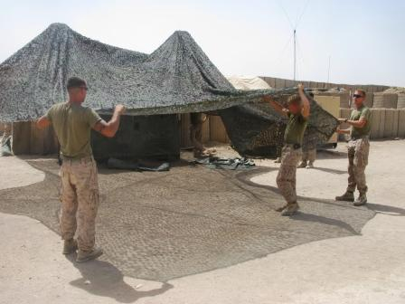 Marines attempt to provide some shade for their generators at COP Reilly.