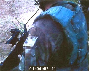Footage captured by a camera mounted on a helmet during a patrol in Afghanistan in Sept. 2011, showed a British Royal Marine shooting a man in the chest. The Royal Marine was found guilty of murder during a court-martial in England on Friday. (AP Photo/ Ministry of Defence)