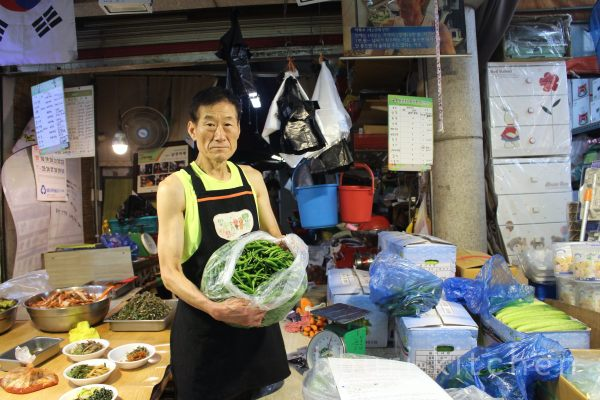 Mr. Lee Bok-su of Mangwon Market shows us his home-grown chillies