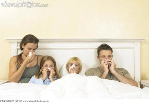 Sick family in bed