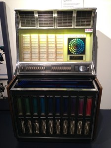 Rock-Ola Jukebox. This jukebox featured colored liquid bands around it. Bubbles were added to the liquid later as a point of interest to attract consumers to play selections from the machine.