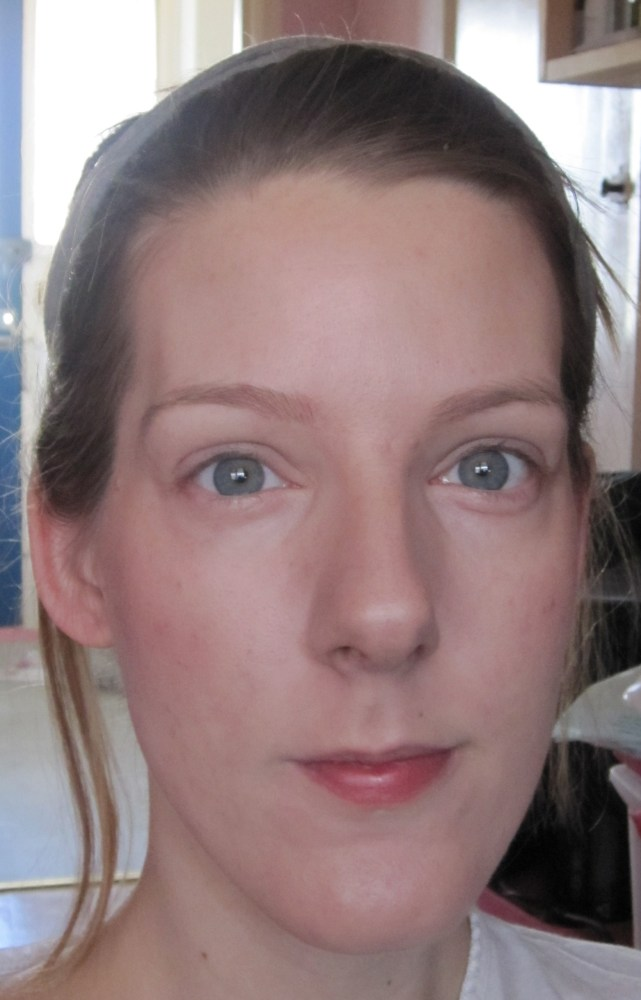 Liz Earle Perfect Finish Powder Foundation with blusher and highlighter applied.