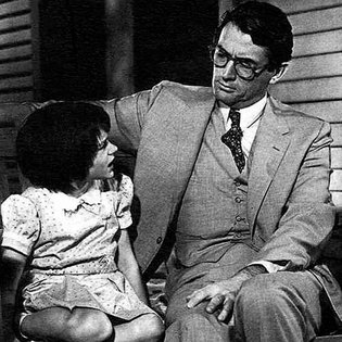 Atticus talking to his daughter, Scout in the film version of the book