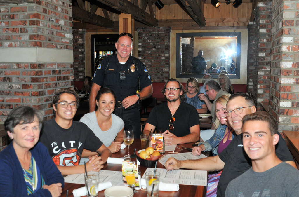 Behind the Badge - Anaheim officers act as food servers to raise