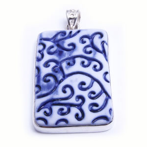 Fern is a hand carved rectangular pendant of glazed porcelain set in sterling silver. Available in four colours.