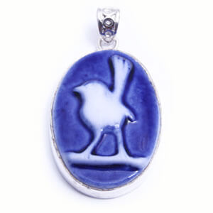 Wren, hand carved porcelain pendant set in sterling silver. Available in four colours