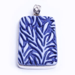 Bamboo is a hand carved rectangular porcelain pendant glazed and set in sterling silver. Available in blue, grey, red and light blue.
