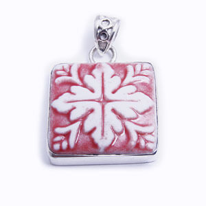 Mosaic is a hand carved square porcelain pendant glazed and set in sterling silver. Available in red, blue, grey and light blue.