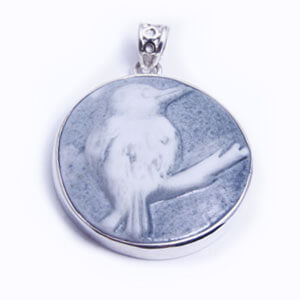 Kingfisher, a round handcarved porcelain pendant, set in sterling silver. Available in grey, blue, light blue and red.