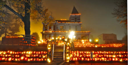 Tom Hindman photo Kenova's Pumpkin House, located at 748 Beech Street, owner Ric Griffith has been carving pumpkins that grace his house and lawn for his Halloween displays. He started with just 5 pumpkins in 1970 and has been displaying pumpkins every Halloween. At night, the lights can be seen from across the river in Ohio. Carved pumpkins adorn the grounds and are also displayed along the edges of this 115-year-old Victorian structure. He has included racks of pumpkins that have a computerized musical program, that plays such classics as the 1812 Overture. Over 3000 Jack 'O Lanterns will be carved for this year's display. In a conversation early Sunday morning Griffith said that some of his displays were in need of repair due to high traffic in the front yard several pumpkins were stepped on or rolled off their perch. HGTV was scheduled to arrive Sunday to film his extravaganza for a show to be aired in October 2012. The Mayor of Kenova, Griffith has received national attention over the past couple of years after being featured on the Ellen DeGeneres show and the Today Show. Volunteers are what make it happen with pumpkins being carved daily and Griffith stated that he would still be carving pumpkins today. The city has converted the street into a one lane, one way with vendors along Beech St. & handycap parking in front of the house along with a viewing area.