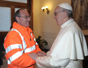 Pope Francis greets Vatican worker after celebrating Mass in chapel of residence