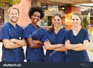 stock-photo-portrait-of-medical-team-standing-outside-hospital-361337135
