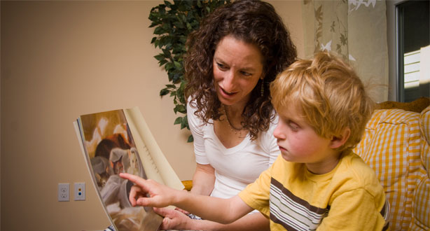Susan Ruzzo working with a young boy at Bend Speech and Language Clinic in Bend, Oregon
