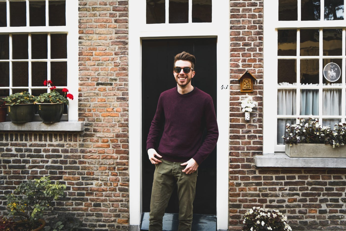 me in front of a door of a house in the beguinage