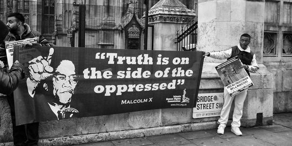 truth is on the side of the oppressed malcolm x banner