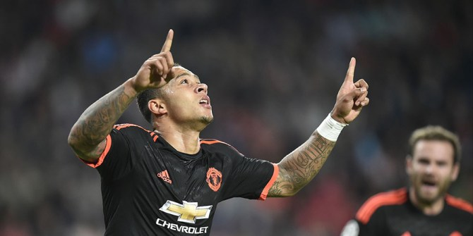Manchester's Dutch forward Memphis Depay celebrates after scoring the opening goal during the UEFA Champions League Group B football match between PSV Eindhoven and Manchester United at the Philips stadium in Eindhoven, Belgium on September 15, 2015. AFP PHOTO / JOHN THYS