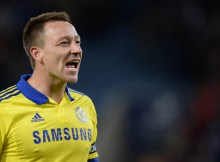 """Chelsea's English defender John Terry celebrates after the English Premier League football match between Leicester City and Chelsea at King Power Stadium in Leicester, central England on April 29, 2015.  AFP PHOTO / OLI SCARFF  RESTRICTED TO EDITORIAL USE. No use with unauthorized audio, video, data, fixture lists, club/league logos or """"live"""" services. Online in-match use limited to 45 images, no video emulation. No use in betting, games or single club/league/player publications."""