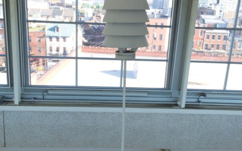 A temperature sensor with a special housing to protect it against UV light; this sensor is situated in a skylight in the office.