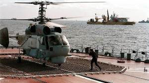 A Navy helicopter prepares to take off during the rescue operation for the sunken nuclear submarine Kursk from aboard the Russian flagship Peter the Great, in the Barents Sea, some 100 km from Severomorsk, 21 August 2000.  Russia's navy announced Monday that all 118 crew on the sunken nuclear submarine Kursk were dead.    (Photo credit should read -/AFP/Getty Images)