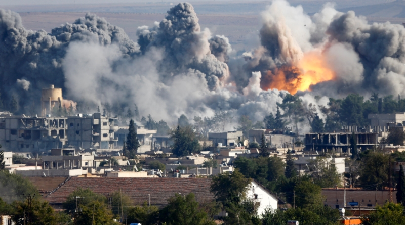 Smoke rises over Syrian town of Kobani after an airstrike, as seen from the Mursitpinar border crossing on the Turkish-Syrian border in the southeastern town of Suruc in Sanliurfa province, October 18, 2014. A U.S.-led military coalition has been bombing Islamic State fighters who hold a large swathe of territory in both Iraq and Syria, two countries involved in complex multi-sided civil wars in which nearly every country in the Middle East has a stake..   REUTERS/Kai Pfaffenbach (TURKEY  - Tags: MILITARY POLITICS CONFLICT TPX IMAGES OF THE DAY)   - RTR4ANKO