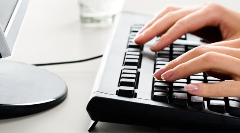 Photo of female hands on the keyboard of computer