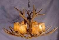 Atmosphere of a Hunting Lodge with Antler Light Fixtures ...