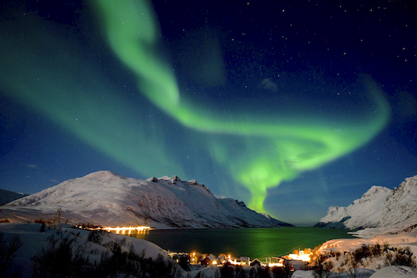 Image: The aurora borealis, or northern lights, are seen on the sky above the village of Ersfjordbotn near Tromso in northern Norway