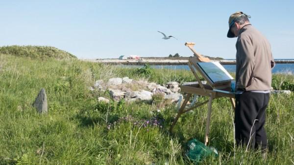 Bill Paarlberg paints on Smuttynose Island. Photo by Nancy Grace Horton.