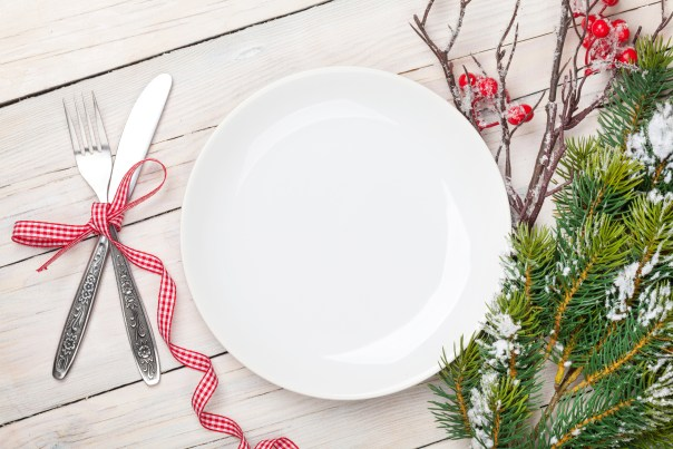 Empty plate, silverware and christmas tree