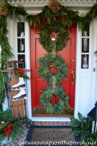 Front Porch Decorated for Christmas with Three Wreaths on ...