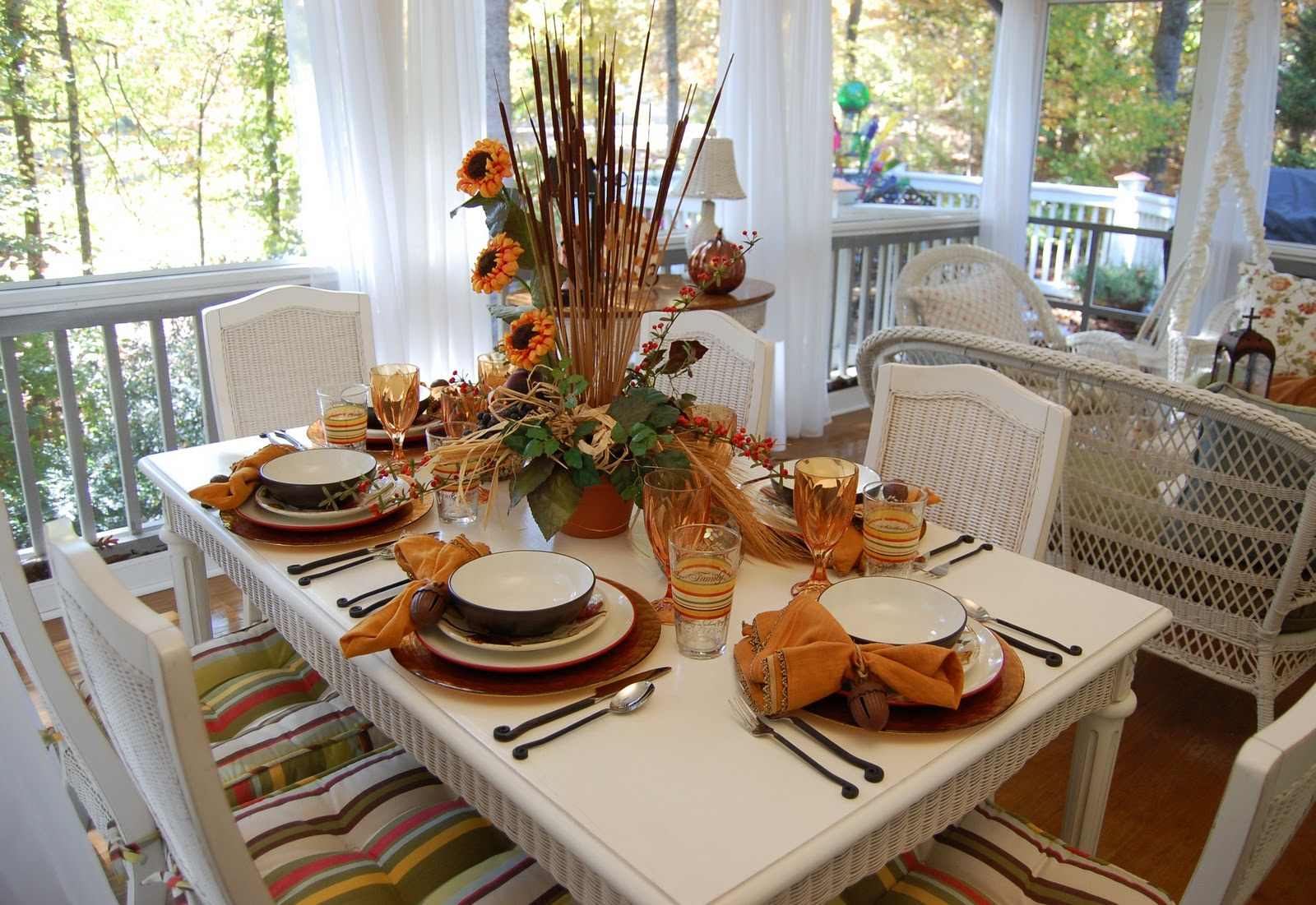 Fall dining on the porch celebrating the russet shades of