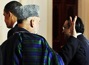 President Hamid Karzai with Asif Ali Zardari (Courtesy: rediff)