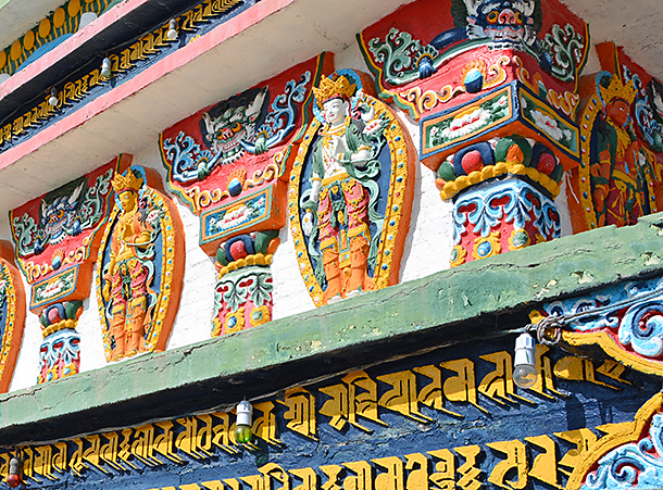 Close-up of hand-painted art and Buddhas from the third floor, Gomar, REbkong, Tibet
