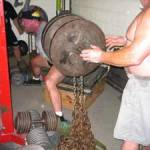 Chuck Vogelpohl crushing the Box Squat with chains