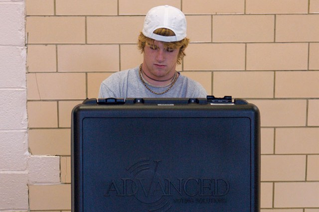 A young man votes in the presidential election in Arlington, Va.