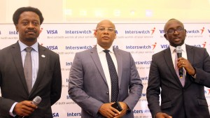 L-R, Country Director, Visa West Africa, Ade Ashaye, GMD, Interswitch, Mitchell Elegbe and DCEO, Switching and Processing, Interswitch