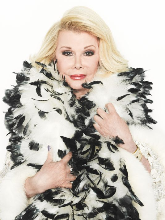"Joan Rivers Blasts Archangel Michael's ""Gaudy Wings"", Already Ruffling Feathers in Heaven"