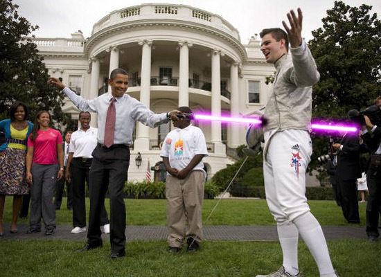 Obama Stabbing Christians With Light Sabers