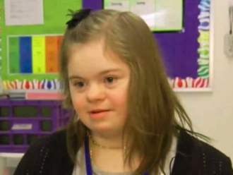 basketball players defend girl with down syndrome