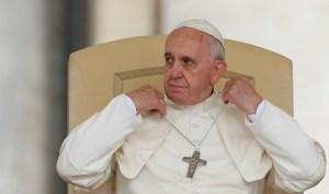 Pope Adjusts Pectoral Cross